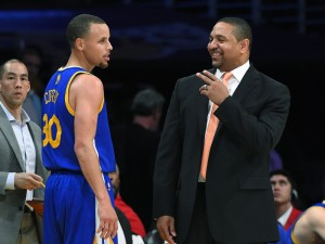 Golden State Warriors guard Stephen Curry, left, talks with coach Mark Jackson after achieving a triple-double, during the second half of an NBA basketball game against the Los Angeles Lakers, Friday, April 11, 2014, in Los Angeles. The Warriors won 112-95. (AP Photo/Mark J. Terrill)