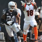 Cincinnati's AJ Green catches a pass against Charles Woodson in Week 1. (Photo: Christopher Chung / Press Democrat)