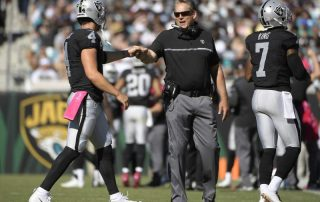 Coach Jack Del Rio wants a fist bump, but the Raiders have yet to beat a good team in 2016. (Photo credit: Associated Press)