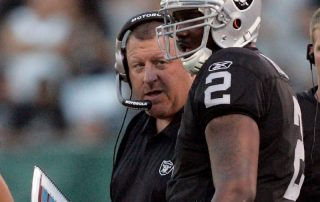 Raiders head coach Tom Cable with JaMarcus Russell in 2009. Things worked out great.